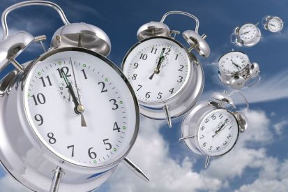 3994442 - time flying concept - alarm clocks disappearing into the distance